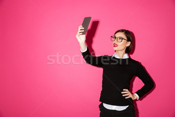 Young lady making selfie on smartphone isolated Stock photo © deandrobot