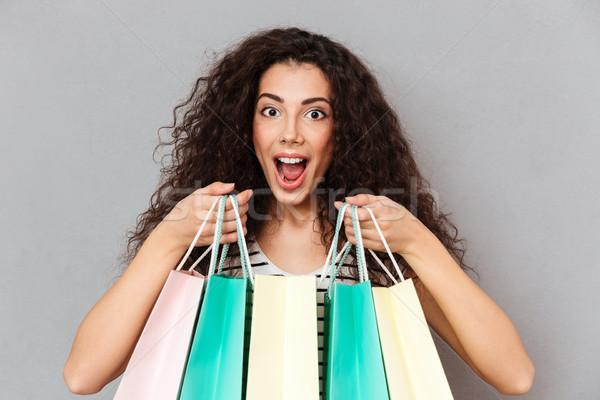 Close up portrait of excited female shopaholic making shopping b Stock photo © deandrobot