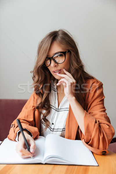 Portrait of a thoughtful woman Stock photo © deandrobot