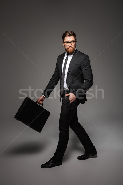 Full length portrait of a handsome young businessman Stock photo © deandrobot