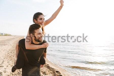 Feliz joven compañera atrás caminando Foto stock © deandrobot