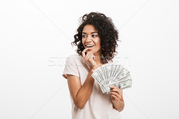 Joyous american woman with afro hairstyle and big smile holding  Stock photo © deandrobot
