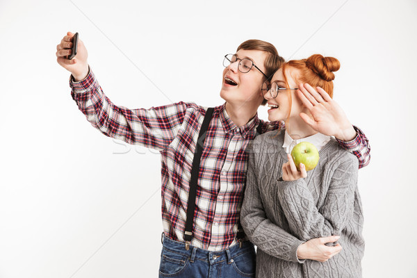 Smiling couple of school nerds taking selfie Stock photo © deandrobot