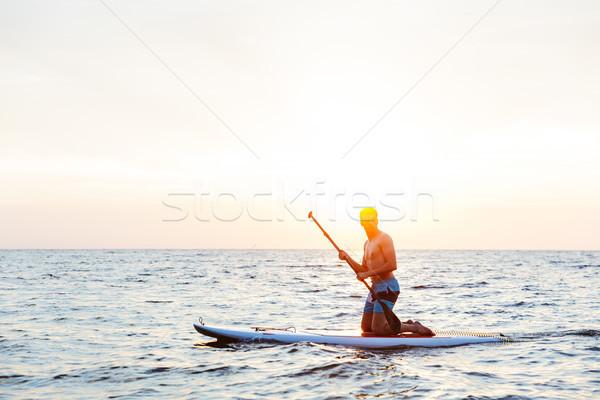 Jóképű férfi kajakozás tó tenger kép fiatal Stock fotó © deandrobot