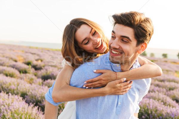 Sorridente campo de lavanda juntos piggyback Foto stock © deandrobot