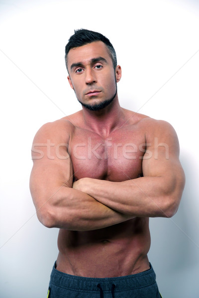 Portret gespierd man permanente armen gevouwen Stockfoto © deandrobot