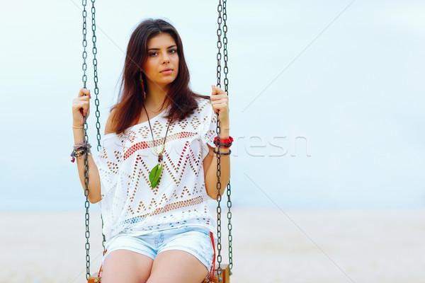 Jungen schöne Frau Sitzung Swing Strand Frau Stock foto © deandrobot