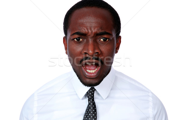 Angry african busienssman screaming on white background Stock photo © deandrobot