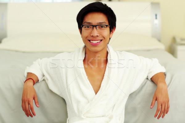 счастливым человека халат кровать спальня Сток-фото © deandrobot