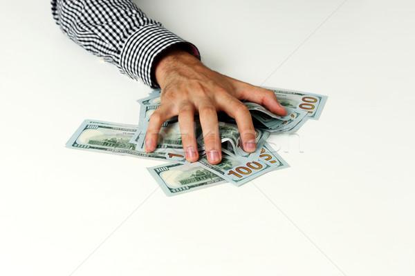 Mężczyzna strony utrzymać dolarów tabeli Zdjęcia stock © deandrobot