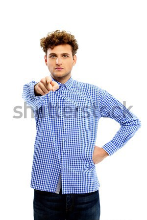 Serious man pointing at you over white background Stock photo © deandrobot