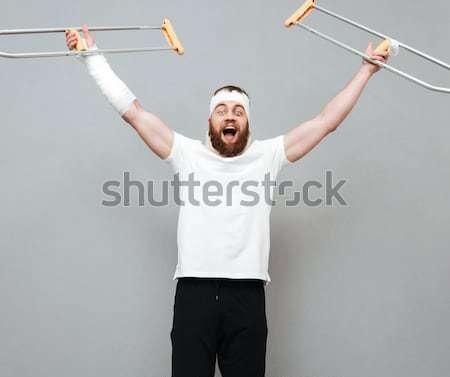 Portret sportowe człowiek hantle biały strony Zdjęcia stock © deandrobot