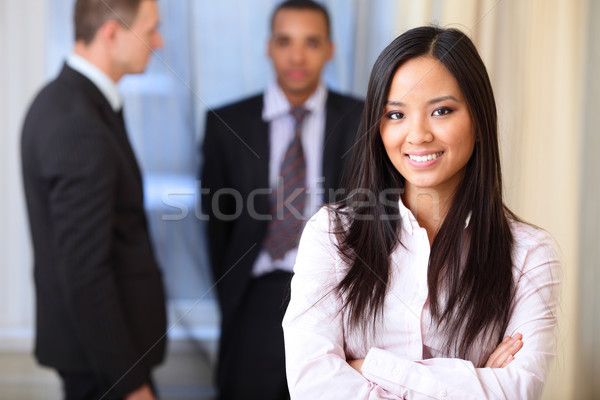 Portrait of a young beautiful asian woman in a business environment Stock photo © deandrobot