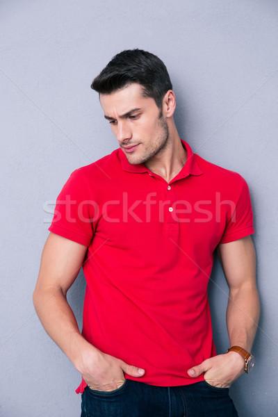 Portrait of a pensive young man Stock photo © deandrobot