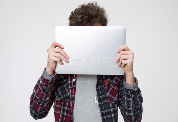 молодым человеком лице ноутбука серый человека волос Сток-фото © deandrobot