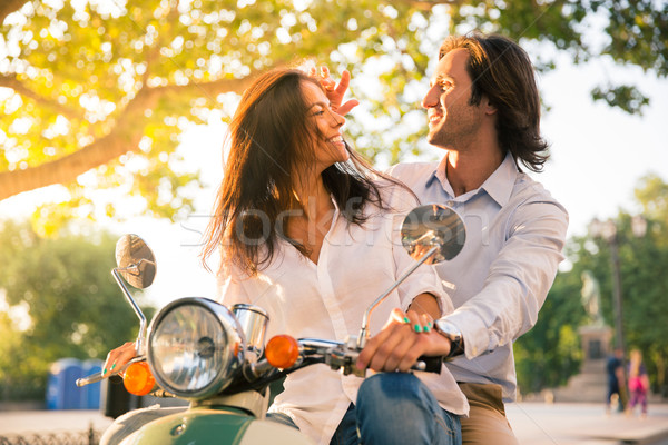 Cheerful european couple flirting on scooter Stock photo © deandrobot