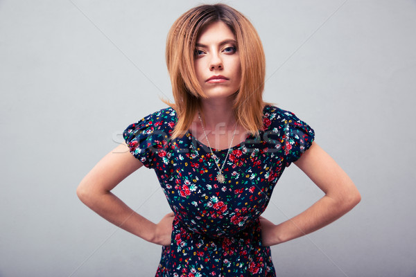 Angry woman looking at camera Stock photo © deandrobot