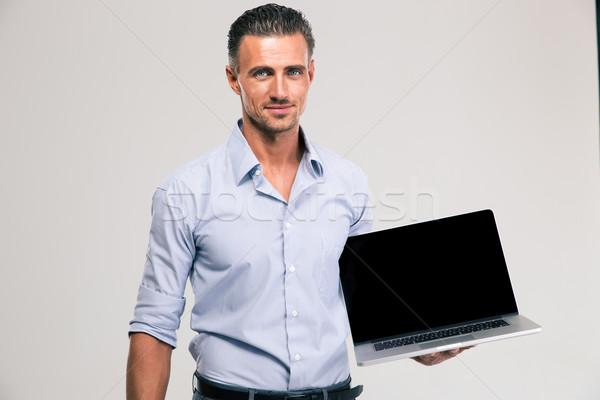 Empresário computador portátil tela retrato feliz Foto stock © deandrobot