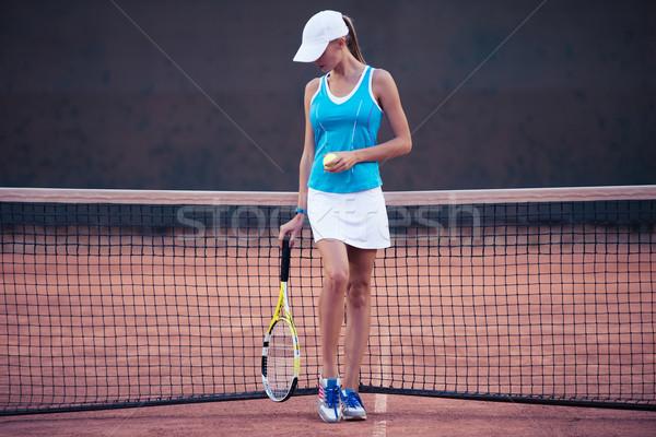 Stock photo: Girl playing in tennis