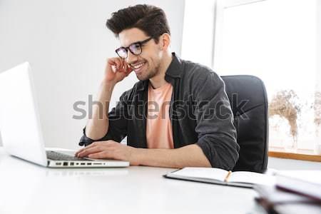 Portrait of a sad man looking at bills Stock photo © deandrobot