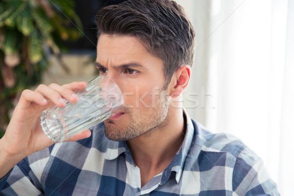 Man drinking water  Stock photo © deandrobot