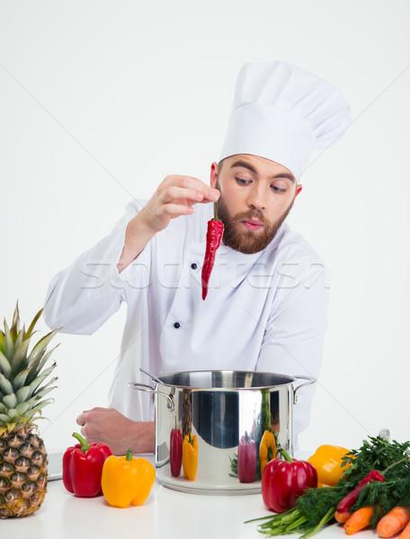 Jóképű szakács szakács ételt készít portré izolált Stock fotó © deandrobot