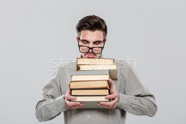 épuisé étudiant verres livres élégant Photo stock © deandrobot