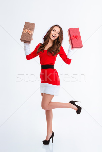 Cheerful woman in santa claus cloth holding gift boxes Stock photo © deandrobot