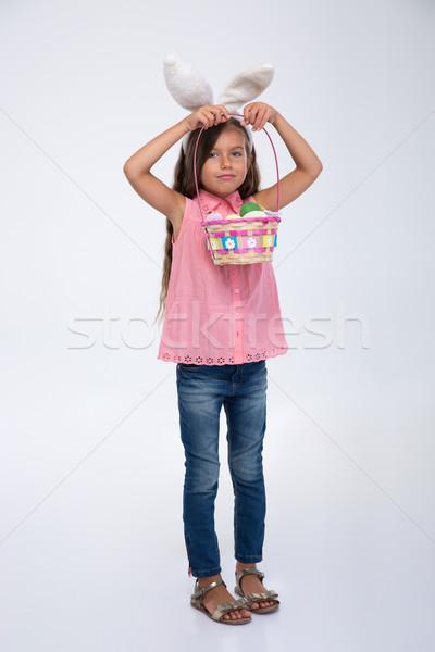 Little girl with bunny ears holding basket of eggs Stock photo © deandrobot