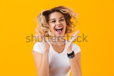 Charming positive young woman in checkered shirt eating fries Stock photo © deandrobot