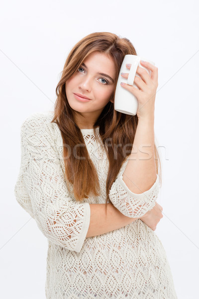 Charming attractive young woman holding white mug  Stock photo © deandrobot