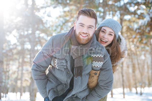 ?ouple looking at camera in winter park Stock photo © deandrobot