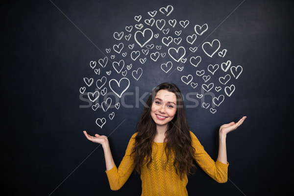 Mujer hermosa dibujo corazones palmas pizarra Foto stock © deandrobot
