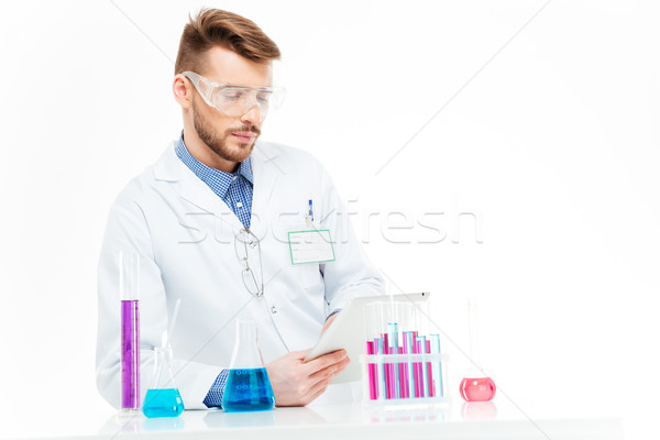 Chemist using tablet computer Stock photo © deandrobot