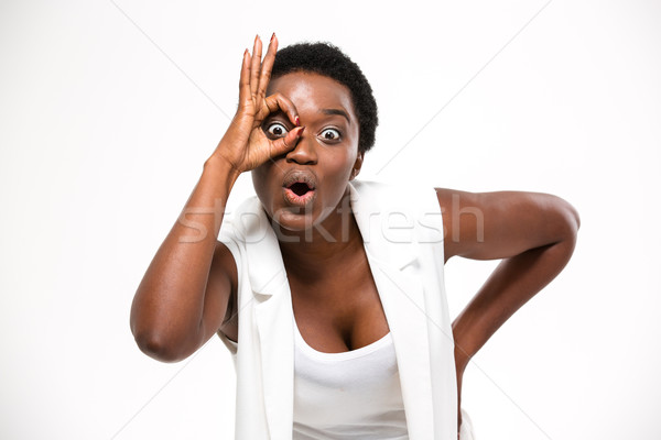 Amazed pretty african american woman making funny face with hand  Stock photo © deandrobot