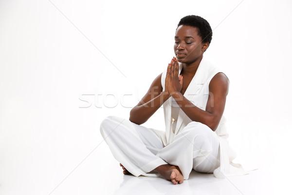 瞑想 かなり アフリカ系アメリカ人 若い女性 座って ヨガのポーズ ストックフォト © deandrobot