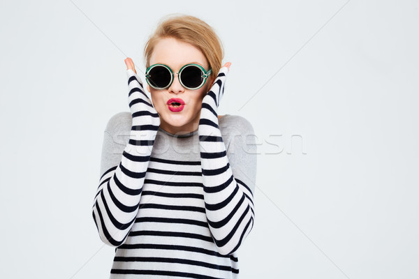 Amazed woman in sunglasses  Stock photo © deandrobot