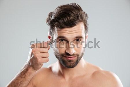 Fiatal boldog férfi elektromos borotva izolált Stock fotó © deandrobot