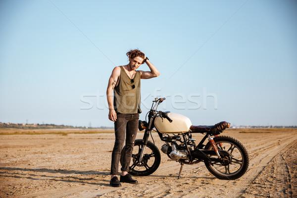 Fiatal brutális férfi fekete áll motorkerékpár Stock fotó © deandrobot