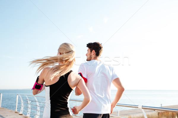 Hátulnézet pár testmozgás maraton edzés fitnessz Stock fotó © deandrobot