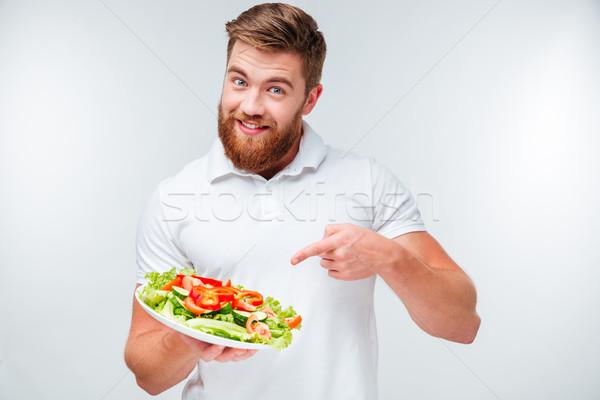 счастливым бородатый человека указывая пальца пластина Сток-фото © deandrobot