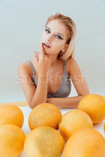 чувственный женщину желтый сидят прикасаться губ Сток-фото © deandrobot