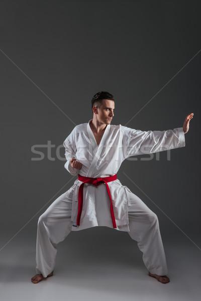Guapo práctica karate kimono aislado Foto stock © deandrobot
