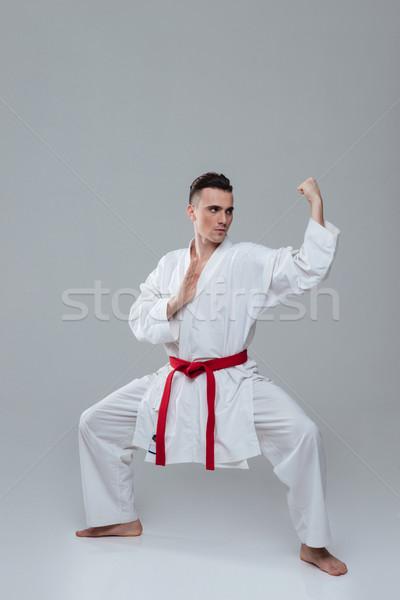 Genç yakışıklı kimono uygulama karate Stok fotoğraf © deandrobot