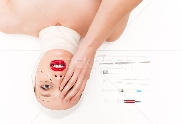 Surprised woman in bandages Stock photo © deandrobot