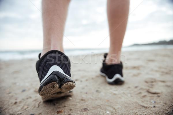 Runner feet running on road Stock photo © deandrobot