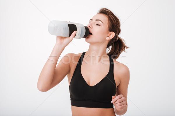 Fitnessz nő ivóvíz fotó hihetetlen fiatal áll Stock fotó © deandrobot