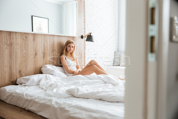 Young woman lying on bed Stock photo © deandrobot