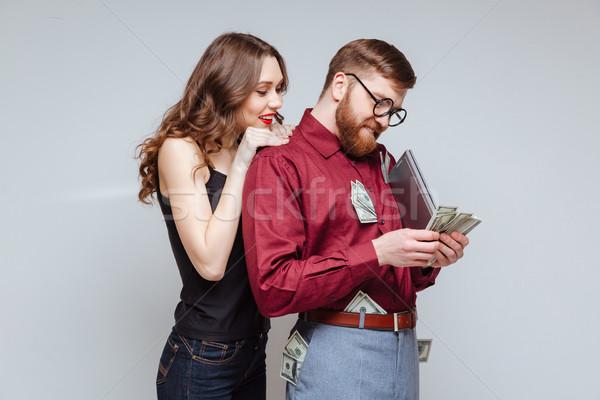Csinos lány hát férfi stréber áll Stock fotó © deandrobot