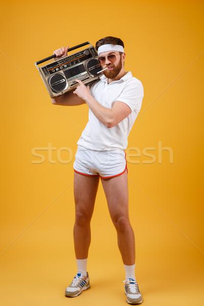 Komoly fiatalember visel napszemüveg tart szalag Stock fotó © deandrobot
